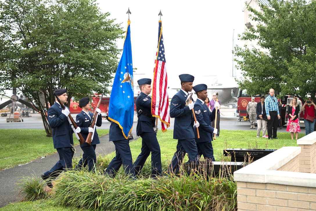 Members from the Dover Air Force Base Honor Guard march during a 9/11 Memorial Service Sept. 11, 2018, at the Air Mobility Command Museum on Dover AFB, Delaware. The annual memorial service honors the civilian casualties of the terrorist attack as well as the police officers, firefighters and emergency first responders who lost their lives attempting to save them.