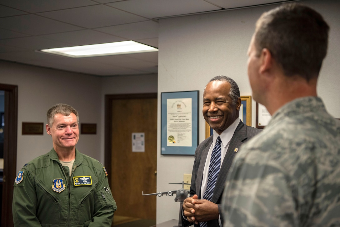 Dr. Ben Carson, Housing and Urban Development secretary, meets with Col. Craig Peters (left), 512th Airlift Wing commander, and Col. Joel Safranek (right), 436th Airlift Wing commander, prior to a 9/11 Memorial Service Sept. 11, 2018, at Dover Air Force Base, Delaware. Carson was briefed by the commanders about Team Dover's mission.