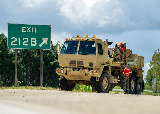 South Carolina Army National Guard Soldiers from the 118th Forward Support Company stage recovery equipment to provide support for disabled vehicles during the lane reversal of I-26 in North Charleston, South Carolina, Sept. 11, 2018.  Approximately 2,000 Soldiers and Airmen have been mobilized to prepare, respond and participate in recovery efforts as forecasters project Hurricane Florence will increase in strength with potential to be a Category 4 storm and a projected path to make landfall near the Carolinas and East Coast.