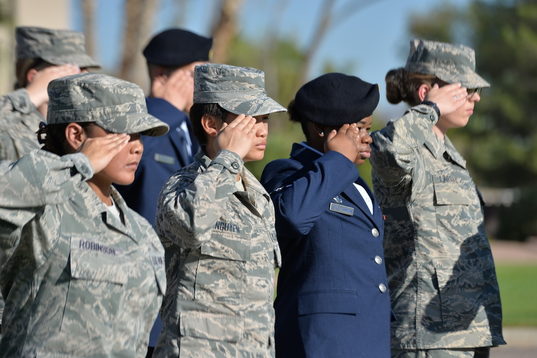 Nellis Airmen render a salute during a 9/11 remembrance ceremony at the U.S. Air Force Warfare Center flag pole, Nellis Air Force Base, Nevada, Sept. 11, 2018.  The Airmen paid special tribute to the victims and families of those lost in New York, Pennsylvania and in the Pentagon. (U.S. Air Force photo by Lorenz Crespo)