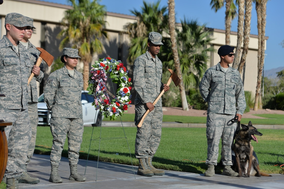 Nellis Air Force Base first responders, honor their fallen comrades during a 9/11 remembrance ceremony at the U.S. Air Force Warfare Center flag pole, Nellis Air Force Base, Nevada, Sept. 11, 2018.  The 9/11 ceremony paid respect to the victims and symbolized Nellis' continued commitment to the Global War on Terrorism.  (U.S. Air Force photo by Lorenz Crespo)