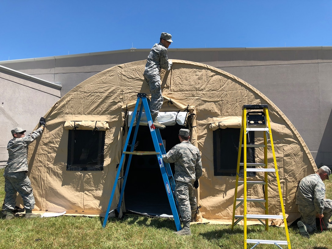 Airmen from the 445th Aeromedical Staging Squadron set up an En Route Patient Staging Shelter outside their squadron July 17, 2018. The shelter is used for temporary staging, casualty care and administration support during contingency operations and can hold up to 50 patients.