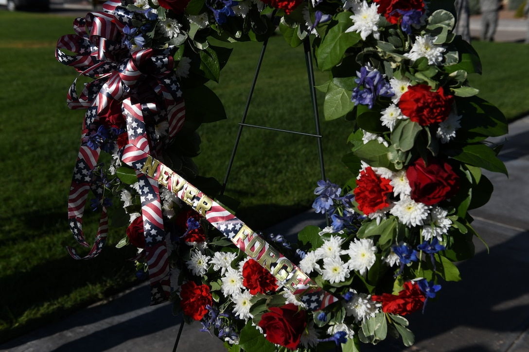 A 9/11 ceremonial wreath is placed at the U.S. Air Force Warfare Center flag pole, Nellis Air Force Base, Nevada, Sept. 11, 2018. Americans will never forget 9/11, as the country came together as an answer to the attack against our homeland. (U.S. Air Force photo by Lorenz Crespo)