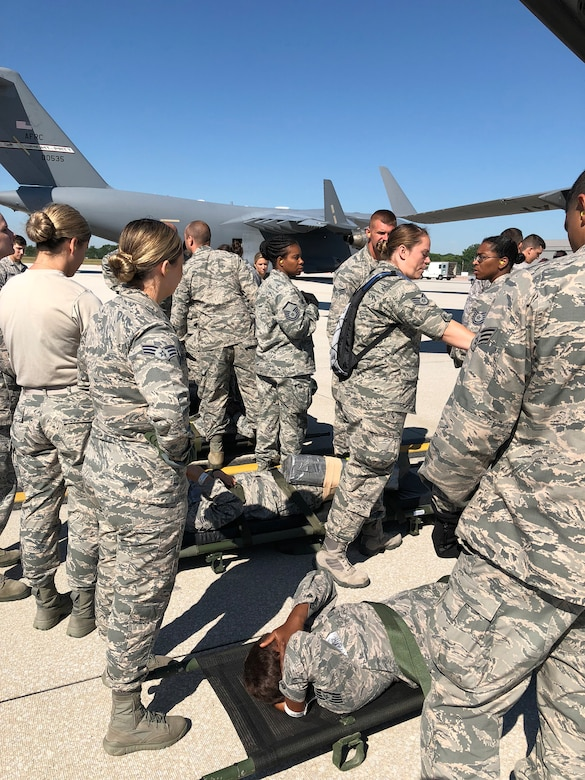 Airmen from the 445th Aeromedical Staging Squadron and 445th Aeromedical Evacuation Squadron work together as they prepare simulated patients played by ASTS Airmen for a flyaway mission July 18, 2018.