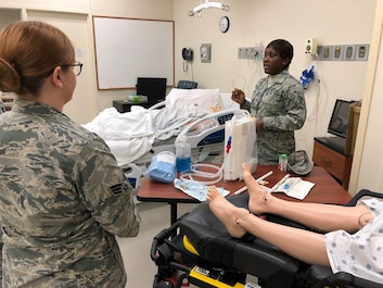 Staff Sgt. Michelle Aholia, 445th Aeromedical Staging Squadron training instructor, gives instructions to her fellow Airmen from ASTS on chest tube insertion and care at the Dayton Veterans Affairs Medical Center's simulator lab during the squadron's annual tour July 23, 2018. The Airmen also practiced suture care and participated in an IV station that day.