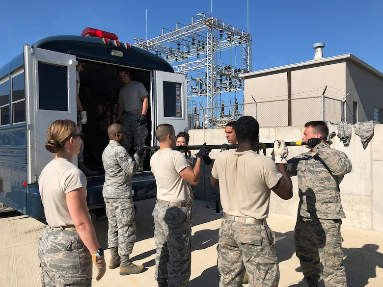 445th Aeromedical Staging Squadron Airmen practice loading litters into an ambus during training conducted at the U.S. Air Force School of Aerospace Medicine as part of their two-week annual tour held in July 15-29, 2018.
