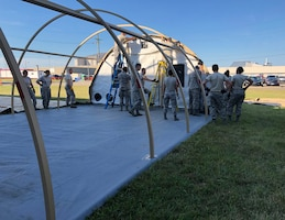 445th Aeromedical Staging Squadron Airmen set up an Alaskan Shelter En Route Patient Staging System during their annual tour July 25, 2018.