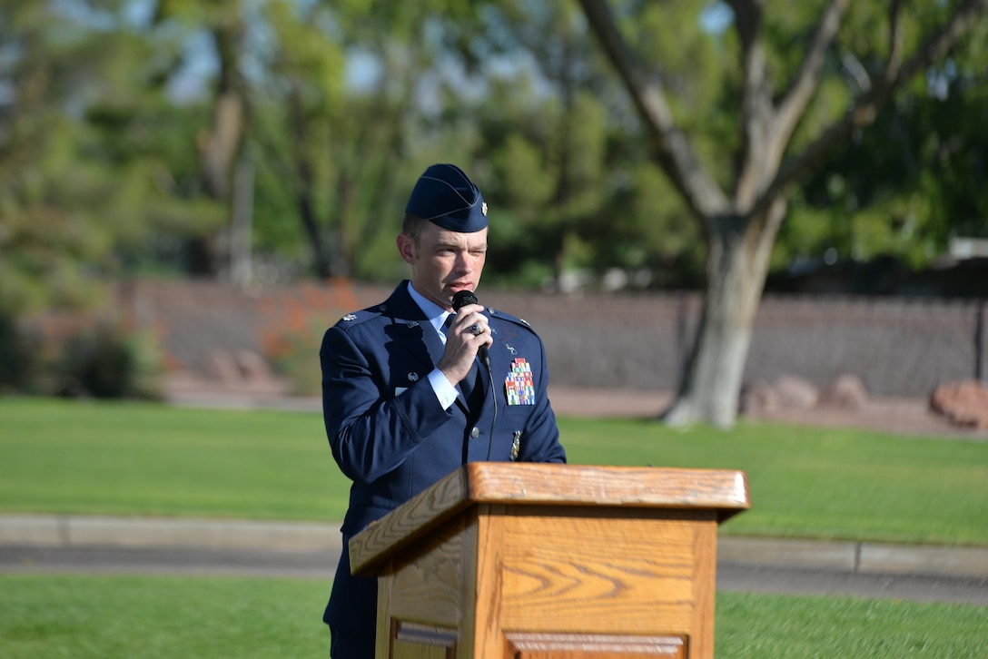 Lt. Col. Patrick Kolesiak, 99th Civil Engineer Squadron commander provides remarks during a 9/11 remembrance ceremony at the U.S. Air Force Warfare Center flag pole, Nellis Air Force Base, Nevada, Sept. 11, 2018.  The 9/11 attacks prompted a new focus by the Department of Defense on fighting terrorism and a host of new security measures in different parts of everyday American life. (U.S. Air Force photo by Lorenz Crespo)