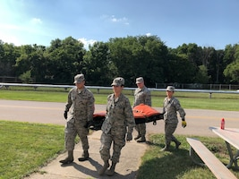 Airmen from the 445th Aeromedical Staging Squadron participate in a four-man litter carry training event as part of their annual tour July 25, 2018. The squadron trained 66 Airmen during their two-week annual tour here July 15-31, 2018.