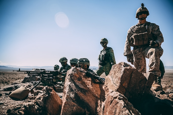 Singapore Guardsmen provide machine gun support for a ground assault on Range 400 during Valiant Mark 2018 aboard the Marine Corps Air Ground Combat Center, Twentynine Palms, Calif., Sept. 5, 2018. Valiant Mark is an annual exercise conducted by U.S. Marines and the Singapore Armed Forces designed to facilitate increased interoperability and strengthen military-to-military relationships through combined-arms integration skills training. (U.S. Marine Corps photo by Lance Cpl. William Chockey)