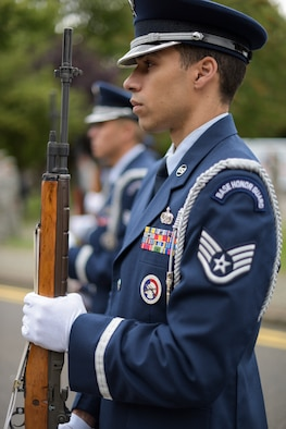 The Team Mildenhall Honor Guard stands by during a 9/11 ceremony at RAF Mildenhall Sep. 11, 2018. Though honor guard details are priority, Team Mildenhall honor guard members must remain current and progress in their career fields. (U.S. Air Force photo by Tech. Sgt. Emerson Nuñez)