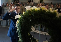 U.S. Air Force Staff Sgt. Christopher Cote, 87th Civil Engineer Squadron fire fighter, salutes a wreath of yellow flowers during a 9/11 memorial ceremony at the Timmermann Center on Joint Base McGuire-Dix-Lakehurst, N.J., Sept. 11, 2018. The ceremony paid special tribute to the victims and families of the attacks as well as the first responders who worked around the clock in the wake of 9/11.