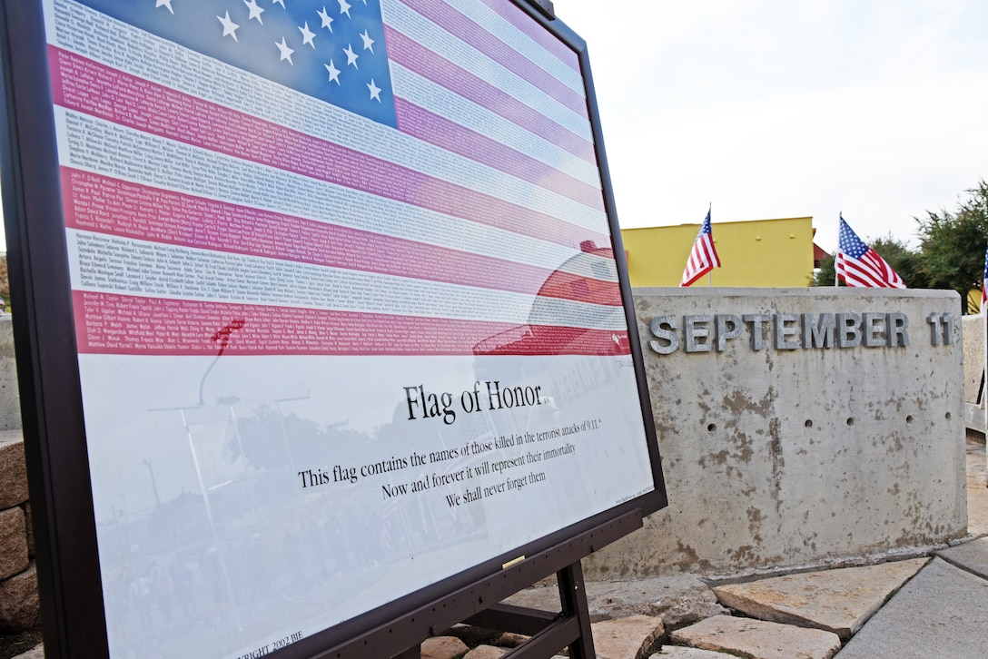 A flag containing the names of all the victims of the Sept. 11, 2001, terrorist attacks rests on an easel at the 9/11 memorial near the San Angelo Museum of Fine Arts in San Angelo, Texas, Sept. 11, 2018. San Angelo hosted a 9/11 ceremony to honor the 2,977 victims who died during the attacks. (U.S. Air Force photo by Staff Sgt. Joshua Edwards/Released)