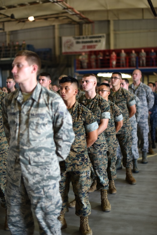 Students with the 312th Training Squadron stand in formation at the Louis F. Garland Department of Defense Fire Academy during a 9/11 memorial service on Goodfellow Air Force Base, Texas, Sept. 11, 2018. The fire academy held the service to honor and remember those who lost their lives during the events of Sept. 11, 2001. (U.S. Air Force photo by Airman 1st Class Seraiah Hines/Released)