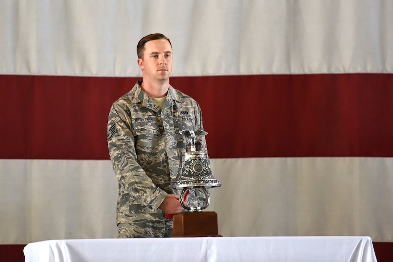 U.S. Air Force Staff Sgt. James Mullenix, 312th Training Squadron instructor, rings a bell five times, three times in a row, to signal the end of watch, according to firefighter tradition in honor of the firefighters who lost their lives on Sept. 11, 2001 during a 9/11 memorial service at the Louis F. Garland Department of Defense Fire Academy on Goodfellow Air Force Base, Sept. 11, 2018. Before the ringing of the bell, there was a reading of the timeline of events that happened on 9/11. (U.S. Air Force photo by Airman 1st Class Seraiah Hines/Released)