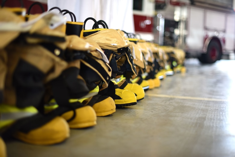 A line of firefighting equipment in front of a podium during a 9/11 memorial service at the Louis F. Garland Department of Defense Fire Academy serves as a reminder of those who gave the ultimate sacrifice on Goodfellow Air Force Base, Texas, Sept. 11, 2018. Goodfellow members came together to remember and honor those who died 17 years ago when answering the call to help. (U.S. Air Force photo by Airman 1st Class Seraiah Hines/Released)