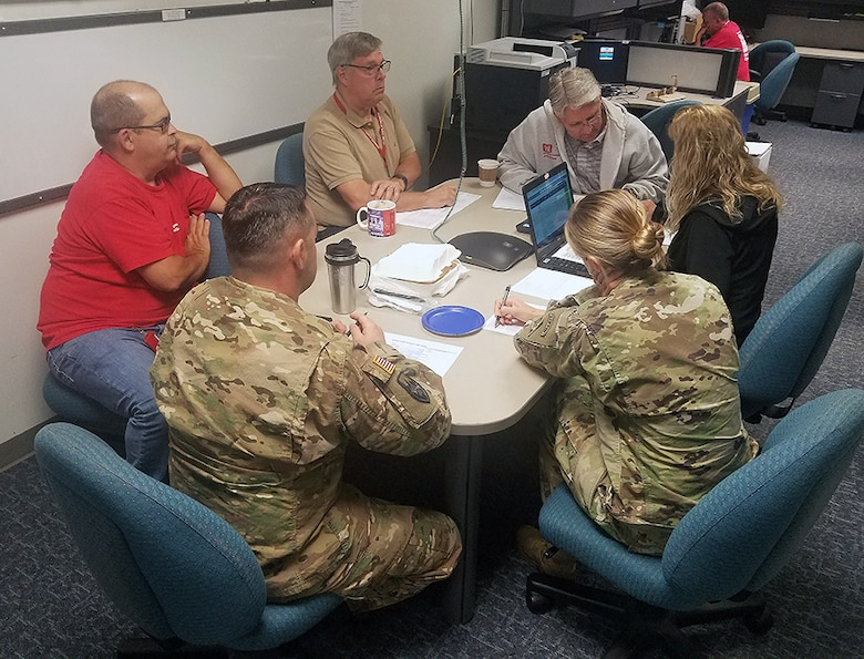 Members of the Emergency Management Team and the district Emergency Operations Center huddle in preparation of today's deployment of 13 temporary power team members to North Carolina ahead of Hurricane Florence's anticipated landfall.