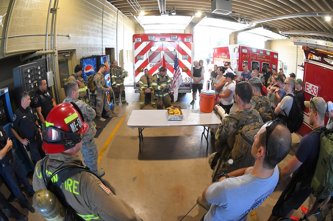 Staff Sgt. Caleb Saunders, 775 Civil Engineering Squadron, reads aloud a short story from a 9/11 first responder survivor, Sept. 11, 2018. Military and local first responders came together to pay tribute and remember those who have given the ultimate sacrifice by participating in the annual 9/11 terrorist attacks Memorial Ruck March. The march started in Kaysville and ended at Hill Air Force Base South Gate, a total of 9.11 miles.