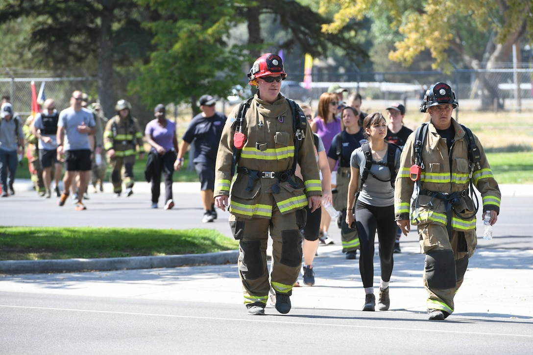 Members from Hill Air Force Base's 775th Civil Engineering Squadron alongside members of Kaysville and Layton fire and police departments, walk together during the 9/11 Memorial Ruck March, commemorating the Sept. 11 terrorist attacks. This is Hill's 3rd annual ruck march and the first teaming up with first responders from local communities. The march started in Kaysville and ended at Hill Air Force Base South Gate, a total of 9.11 miles.
