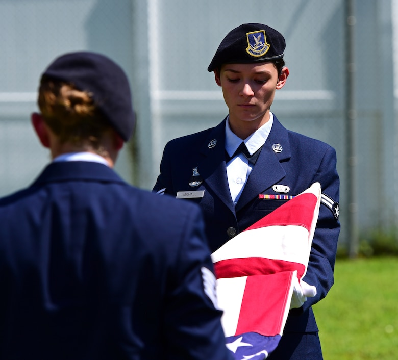 U.S. Air Force Airman 1st Class Arleen Michael, right, and Staff Sgt. Katelyn Grau, left, 325th Security Forces Squadron Airmen, ceremoniously fold the U.S. Flag in remembrance of military working dog (MWD) Jack during his memorial service at Tyndall air Force Base, Fla., Sept. 7, 2018. Jack, a Belgian Malinois, was an explosives and patrol dog who shared a special bond with his handlers. MWDs are afforded military customs and courtesies. (U.S. Air Force photo by Senior Airman Isaiah J. Soliz)