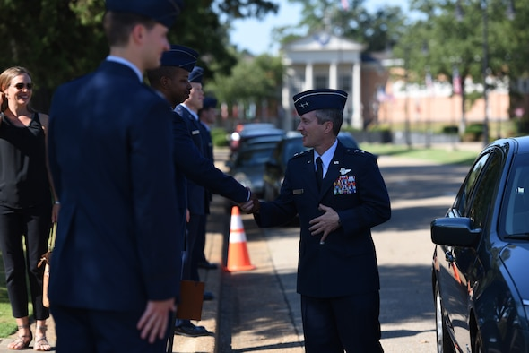 Maj. Gen. Michael D. Rothstein, commander of the Curtis E. LeMay Center and vice commander of Air University at Maxwell Air Force Base, Alabama, greets students of Specialized Undergraduate Pilot Training Classes 18-14/15 at their graduation Sept. 7, 2018, on Columbus Air Force Base, Mississippi. Twenty-five officers completed 53 weeks of training in order to become new, highly trained pilots. (U.S. Air Force photo by Airman 1st Class Beaux Hebert)