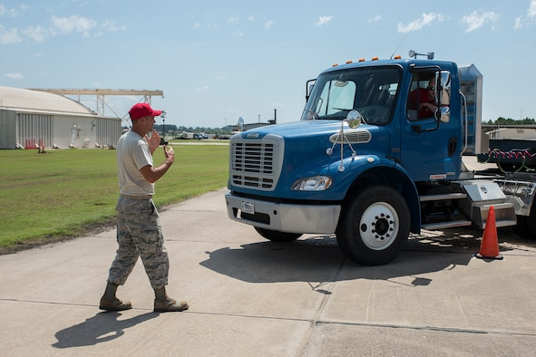 Master Sgt. Bryan Sutton, 188th RED HORSE instructor, offers guidance to a student practicing backing maneuvers on the 3T course at Ebbing ANG Base, Ark., August 29, 2018. The 3T course teaches active, Guard and Reserve Airmen, as well as DOD civilian employees the skills needed to operate tractor-trailers effectively and be able to acquire a military or civilian commercial driver's license. (U.S. Air National Guard photo/Tech. Sgt. John E. Hillier)