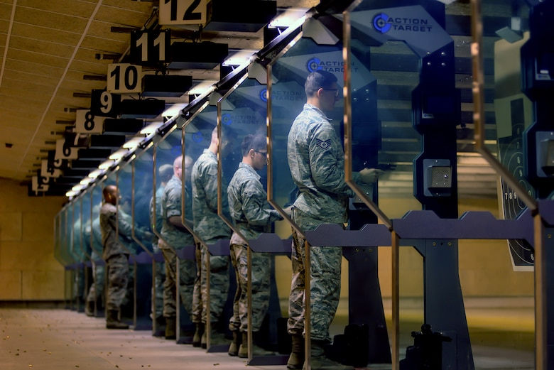 Participants in an Excellence in Competition pistol contest review their scores Aug. 30, 2018, at Offutt Air Force Base, Nebraska. Competitors who score in the top ten percent will have qualified to wear a badge in uniform distinguish themselves and excellent shots. (U.S. Air Force photo by Kendra Williams)