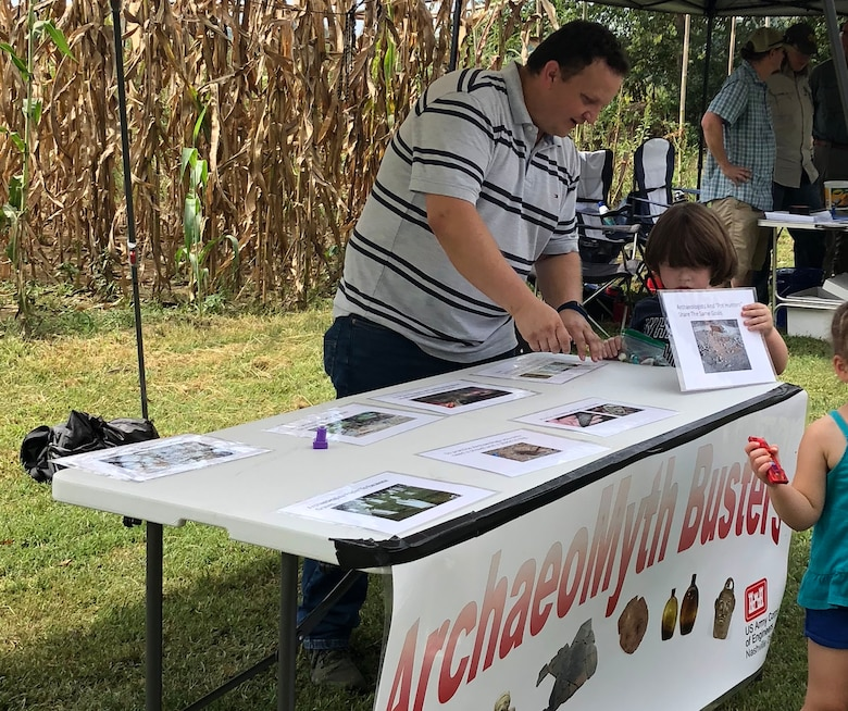 Jordan McIntyre, archaeologist with the U.S. Army Corps of Engineers Nashville District, explains how to protect cultural resources at the ArchaeoMyth Busters table for Tennessee Archaeology Day at Bells Bend Park in Nashville, Tenn., Sept. 8, 2018. (Courtesy Asset)