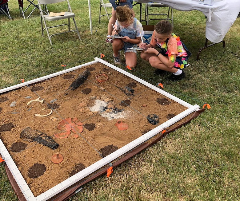 Children learn mapping skills with a replica archaeological house floor during Tennessee Archaeology Day at Bells Bend Park in Nashville, Tenn., Sept. 8, 2018. (Courtesy Asset)