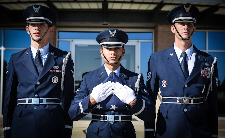 Buckley Air Force Base Mile High Honor Guardsmen prepare to raise the United States flag during a Patriot Day ceremony Sept. 11 2018, on Buckley AFB, Colorado. Team Buckley members held a ceremony in remembrance of the victims and families of those lost in New York, Pennsylvania and the Pentagon during the terrorist attacks on Sept. 11, 2001. (U.S. Air Force photo by Airman 1st Class Michael D. Mathews)