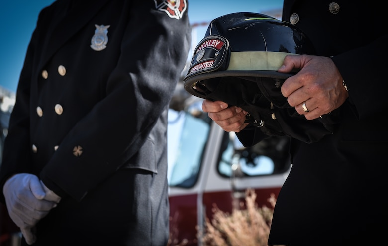 Firefighters assigned to the 460th Civil Engineer Squadron pay their respects to those who sacrificed their lives following the terrorist attacks of 9/11 during a Patriot Day ceremony Sept. 11 2018, on Buckley Air Force Base, Colorado. Team Buckley members held a ceremony in remembrance of the victims and families of those lost in New York, Pennsylvania and the Pentagon during the terrorist attacks on Sept. 11, 2001. (U.S. Air Force photo by Airman 1st Class Michael D. Mathews)