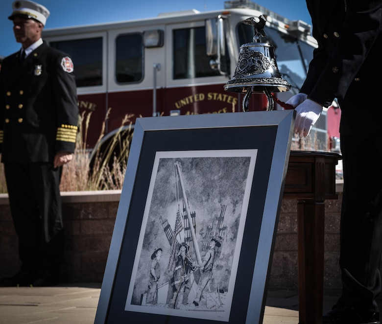 Firefighters assigned to the 460th Civil Engineer Squadron pay their respect to those who sacrificed their lives following the terrorist attacks of 9/11 during a Patriot Day ceremony Sept. 11 2018, on Buckley Air Force Base, Colorado. Team Buckley members held a ceremony in remembrance of the victims and families of those lost in New York, Pennsylvania and the Pentagon during the terrorist attacks on Sept. 11, 2018. (U.S. Air Force photo by Airman 1st Class Michael D. Mathews)