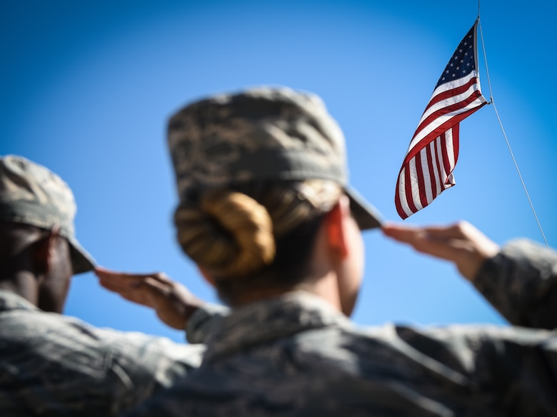 Buckley Air Force Base Airmen salute the United States flag during a Patriot Day ceremony Sept. 11, 2018, on Buckley AFB, Colorado. Team Buckley members held a ceremony in remembrance of the victims and families of those lost in New York, Pennsylvania and the Pentagon during the terrorist attacks on Sept. 11, 2001. (U.S. Air Force photo by Airman 1st Class Michael D. Mathews)