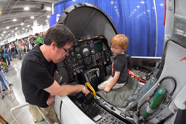 Visitors attending FanX experience an A-10 cockpit flight simulator at the Hill Air Force Base STEM Outreach booth, Sept. 7, Salt Lake City.