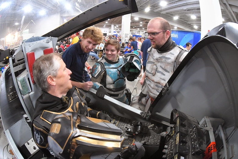 FanX visitors dressed as Star Wars characters experience an A-10 cockpit flight simulator, while talking with Matt Kirk, 518th Software Maintenance Squadron, who was volunteering at the Hill Air Force Base STEM Outreach booth, Sept. 7, 2018, Salt Lake City.