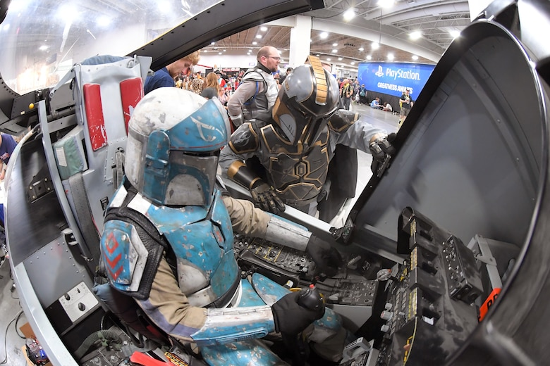 FanX visitors dressed as Star Wars characters try out the A-10 cockpit flight simulator at the Hill Air Force Base STEM Outreach booth, Sept. 7, 2018, Salt Lake City.