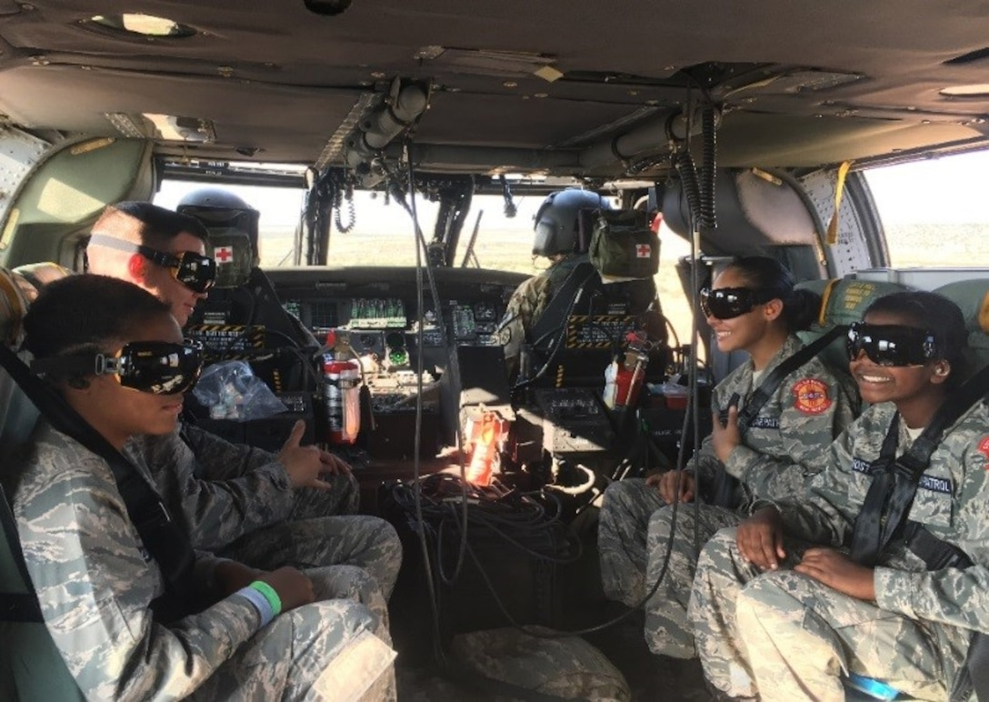 """SANTA ROSA LAKE, N.M. – Civil Air Patrol cadets who had been """"rescued"""" as part of the exercise are evacuated in a Black Hawk U-H60 helicopter to the local airport, Aug. 4, 2018."""