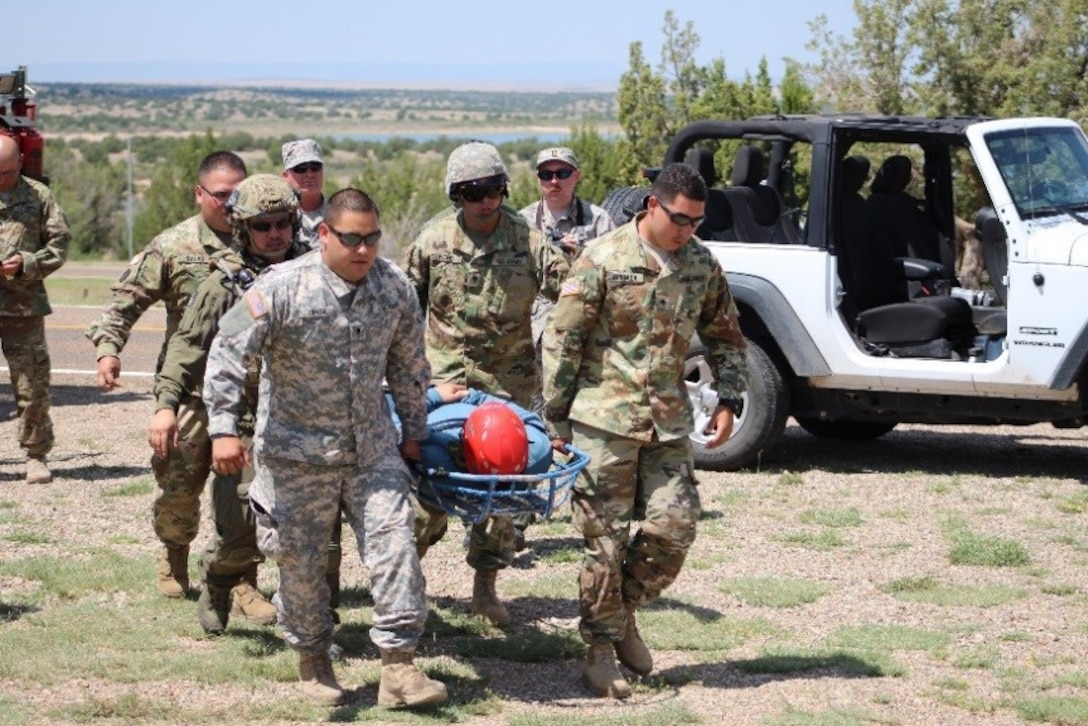 """SANTA ROSA LAKE, N.M. -- Members of the U.S. Air Force Auxiliary Civil Air Patrol and the New Mexico Civil Air Patrol transport one of the """"lost"""" hikers """"rescued"""" during training exercise Operation Pave Hawk, Aug. 4, 2018."""