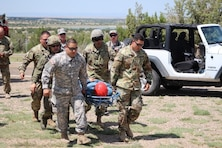 "SANTA ROSA LAKE, N.M. -- Members of the U.S. Air Force Auxiliary Civil Air Patrol and the New Mexico Civil Air Patrol transport one of the ""lost"" hikers ""rescued"" during training exercise Operation Pave Hawk, Aug. 4, 2018."