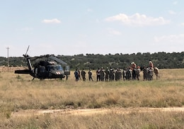 SANTA ROSA LAKE, N.M. -- Participants gather and discuss Operation Pave Hawk, Aug. 4, 2018.