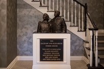 A statue of Zachary and Elizabeth Fisher stands in the foyer of the newly built Fisher House II at Joint Base Elmendorf-Richardson, Alaska, Sep. 10, 2018. The Fisher House Foundation was started in 1990 by the Fishers. The program is a unique private-public partnership established to improve the quality of life for military members, retirees, veterans and their families.