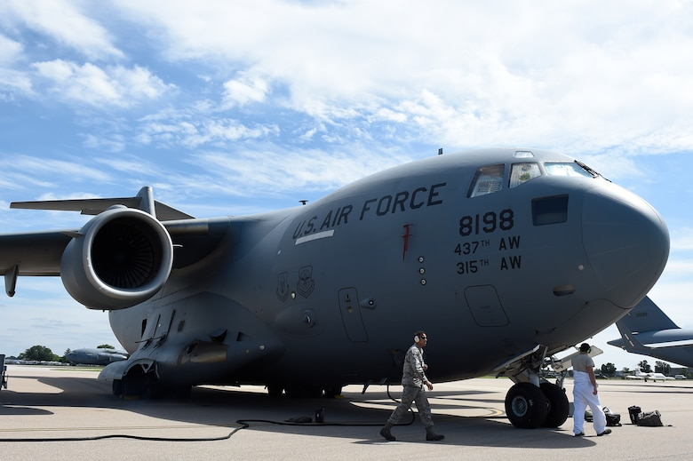 Airmen assigned to the 437th Aircraft Maintenance Squadron conduct post-flight inspections on a Globemaster III C-17 Sept. 12, 2018, at Scott Air Force Base, Ill.