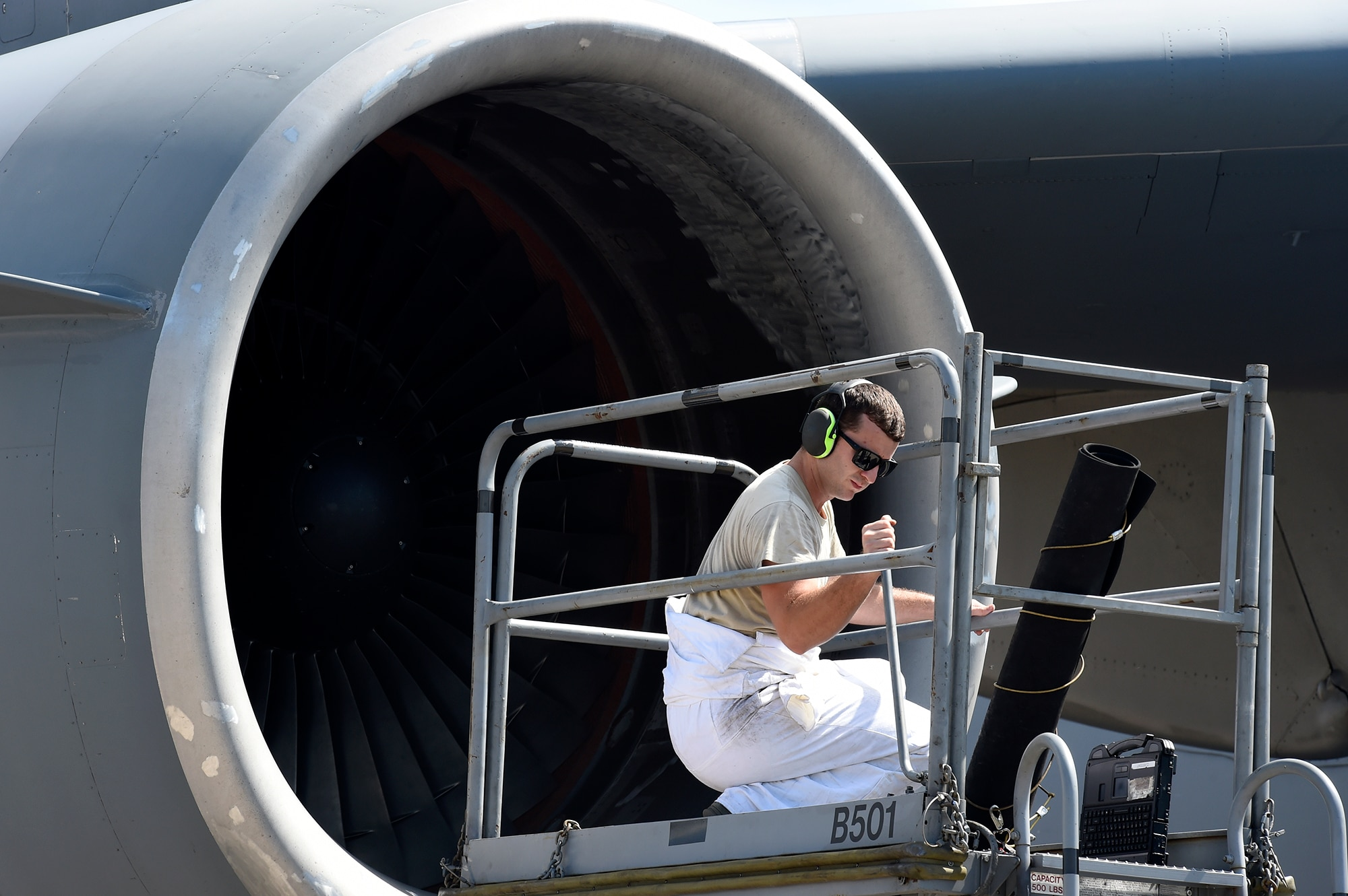 Airman 1st Class Richard Cordell, a 437th Aircraft Maintenance Squadron aerospace propulsion specialist, raises a lift before performing post-flight inspections on a C-17 Globemaster III engine Sept. 12, 2018, at Scott Air Force Base, Ill.