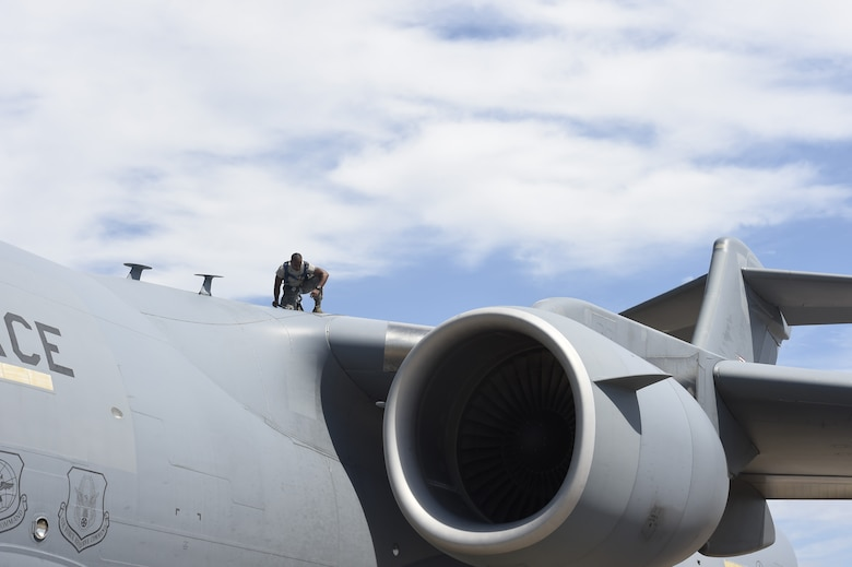 Airman 1st Class Quran Bullock, a 437th Aircraft Maintenance Squadron crew chief, performs post-flight inspections on top of a C-17 Globemaster III Sept. 12, 2018, at Scott Air Force Base, Ill.