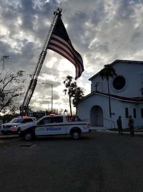 Joint Task Force Guantanamo Troopers and Naval Station Guantanamo Bay residents attended a 9/11 remembrance ceremony at the NSGB chapel, Sept. 11.