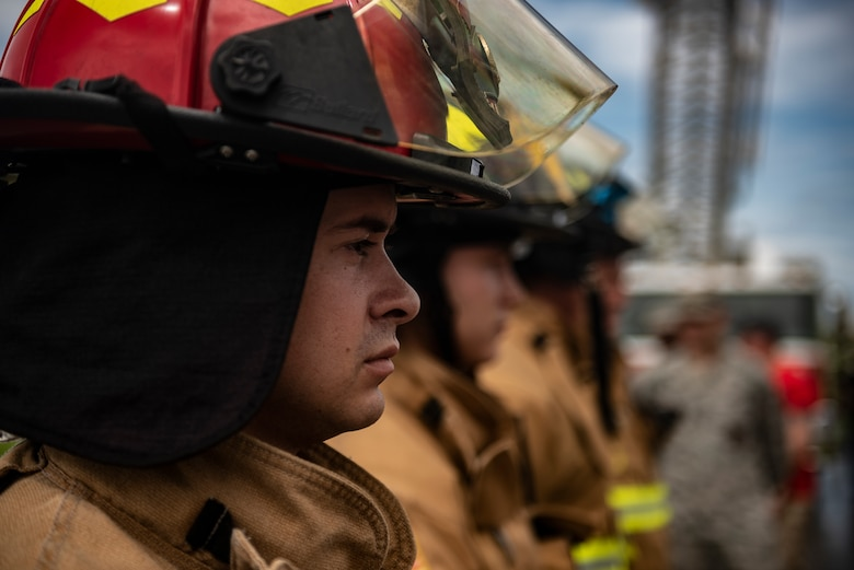 Firefighters from the 18th Civil Engineer Squadron stand at ease before the Kadena Fire Emergency Services 9/11 Memorial Stair Climb Sept. 11, 2018, at Kadena Air Base, Japan. The event was held to honor the sacrifices 417 first responders made during the Sept. 11, 2001, terrorist attacks at the World Trade Center in N.Y. (U.S. Air Force photo by Staff Sgt. Micaiah Anthony)