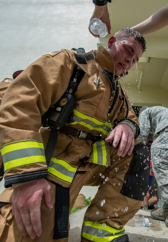 U.S. Air Force Senior Airman Forrest Privette, 18th Civil Engineer Squadron driver operator, cools down after climbing 110 flights of stairs during the Kadena Fire Emergency Services 9/11 Memorial Stair Climb Sept. 11, 2018, at Kadena Air Base, Japan. The event was held to honor the sacrifices 417 first responders made during the Sept. 11, 2001, terrorist attacks at the World Trade Center in N.Y. (U.S. Air Force photo by Staff Sgt. Micaiah Anthony)