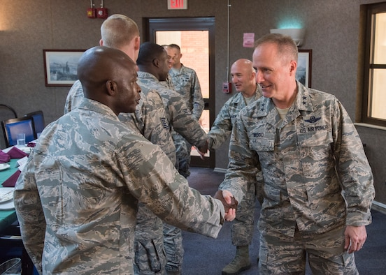 U.S. Air Force Major Gen. John Wood, 3rd Air Force commander, shakes hands with U.S. Air Force Chaplain (Capt.) John Appiah, 39th Air Base Wing chaplain, at Incirlik Air Base, Turkey, Sept. 12, 2018.