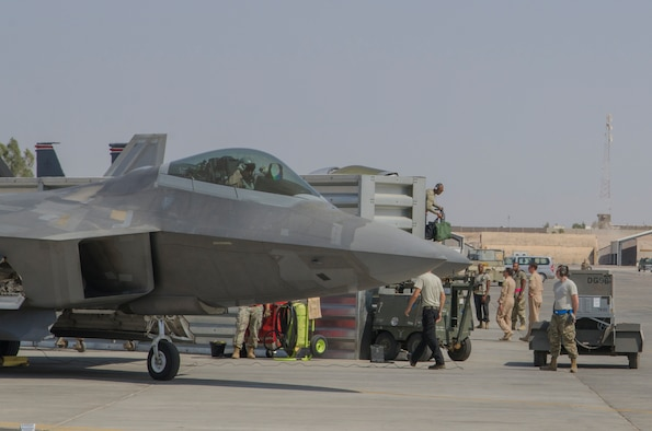 Airmen recover an F-22 Raptor in Southwest Asia.