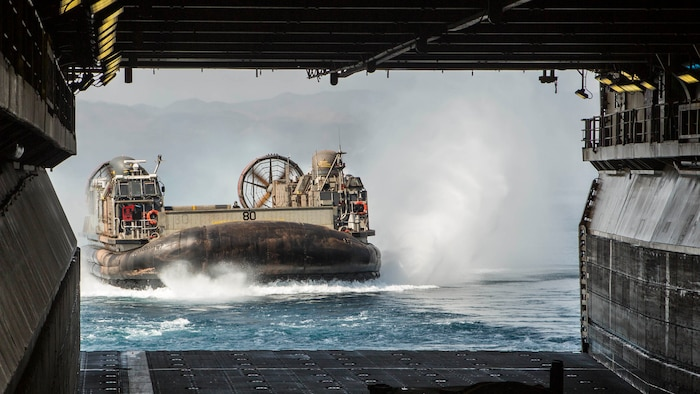 A landing craft, air cushion lands aboard the Wasp-class amphibious assault ship USS Essex during the Theater Amphibious Combat Rehearsal. Led by Naval Amphibious Force, Task Force 51/5th Marine Expeditionary Expedition Brigade, TACR integrates U.S. Navy and Marine Corps assets to practice and rehearse a range of critical combat-related capabilities available to U.S. Central Command, both afloat and ashore, to promote stability and security in the region. U.S. 5th Fleet and coalition assets are participating in numerous simultaneous exercises as part of the greater Theater Counter Mine and Maritime Security Exercise to ensure maritime stability and security in the U.S. Central Command area of responsibility, connecting the Mediterranean and the Pacific through the western Indian Ocean and three strategic choke points.